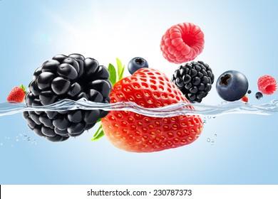 close up view of nice fresh berries on blue background