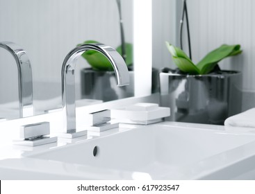 close up view of nice metal faucet in modern bathroom