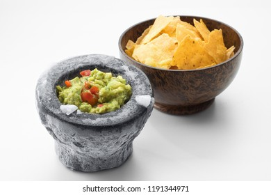 close up view of nice red salsa and corn chips on white background.