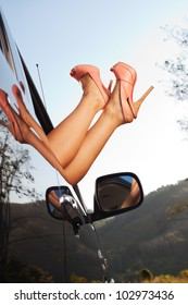 close up view of nice woman's legs getting outta automobile