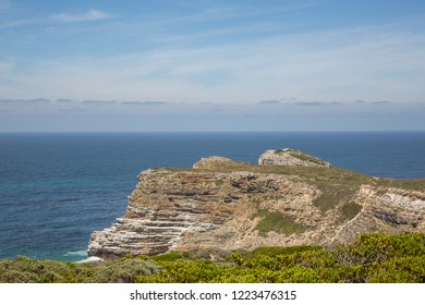 Close up view of the ocean and a rockface in summer