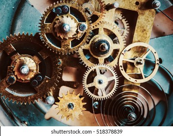 Close view of old clock mechanism with gears and cogs. Conceptual photo for your successful business design. Copy space included.