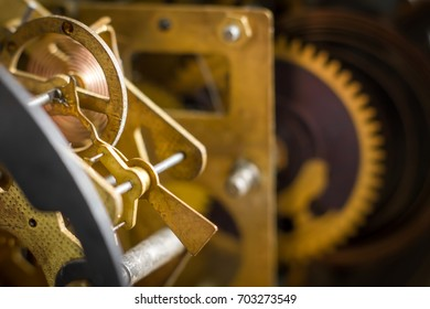 Close view of old clock mechanism with gears and cogs. Conceptual photo for your successful business design. Copy space included. Selective focus