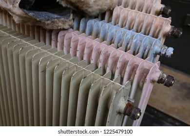 Close up view of old painted radiators. Pattern of ancient heaters. Vintage image of a row of colored equipments. Abstract retro picture.