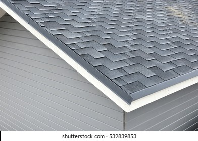 Close up view on asphalt roofing shingles