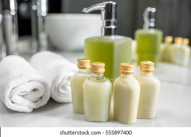 Close up view on the bottles with cosmetics in the hotel bathroom