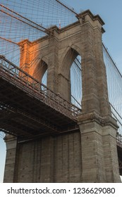 Close up view on Brooklyn bridge with a hit of sun