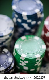 close view on chips piles, casino gambling concept