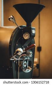 Close up view on coffee roasting machine. Coffee roastery