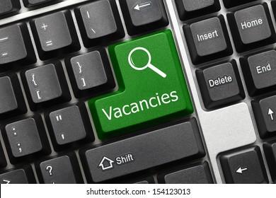 Close up view on conceptual keyboard - Vacancies (green key)