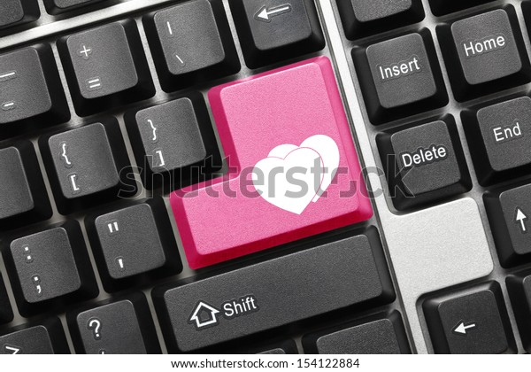 Close up view on conceptual keyboard - Two hearts (pink key)