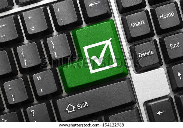 Close up view on conceptual keyboard - Checkbox with tick (green key)