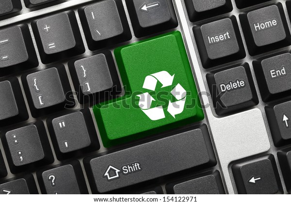 Close up view on conceptual keyboard - Recycling symbol (green key)