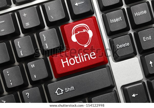 Close up view on conceptual keyboard - Hotline (red key with operator symbol)