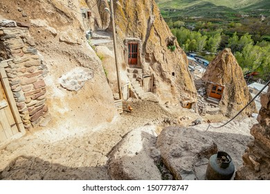 close up view on courtyard and interior of traditional Iranian ancient cave village of troglodyte in Kandovan in East Azerbaijan Province. selective focus