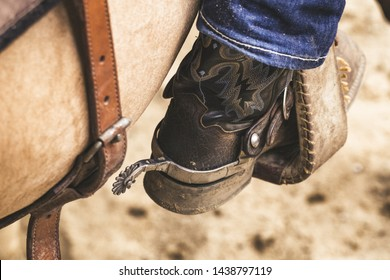 Close up view on cowboy boot with spur