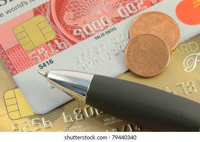 Close up view on credit cards and pen. focus on pen