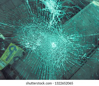 Close up view on a heavily shattered windshield of a car, external