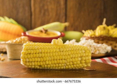 close view on Homemade golden corn cob with melting butter and salt on table.