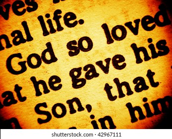 Close up view on a part of biblical text from the Bible, the Gospel of John chapter 3, verse 16, focusing on the words: God so loved - he gave his Son. (Bible in Macro series)