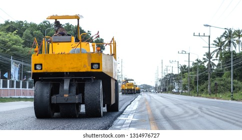 Close view on the road roller working on the road construction site.