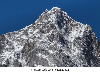 Close view on summit of mount Cholatse with deep blue sky from a trek to Everest base camp in Khumbu region, Sagamartha national park, Himalaya, Nepal