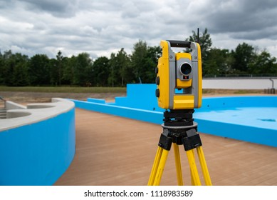 Close view on the theodolite on the construction site