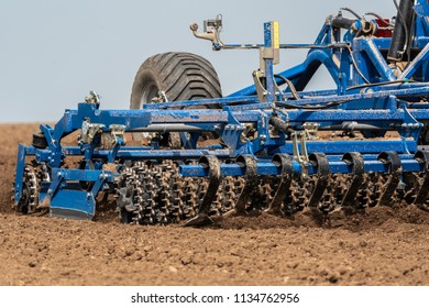 Close view on the tractor harvester working on the field