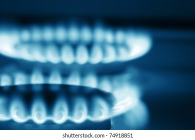 Close up view on two burners of cooker (blue toned)
