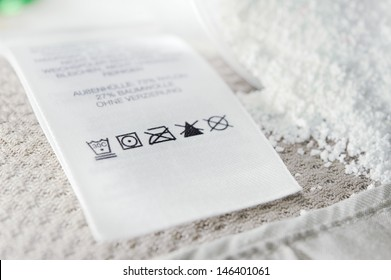 Close up view on an washing label tag and washing powder.
