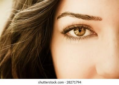 Close view on woman eye.