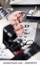 close up view of an optician repairing glasses