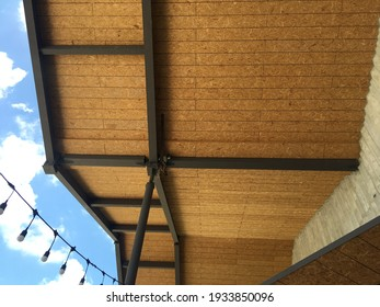 close up view of oriental strands board ceiling with steel structure - Shutterstock ID 1933850096
