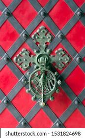 Close up view of an ornamental castle door knocker.