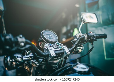 Close up view view over the handlebars of motorcycle, speedometer.