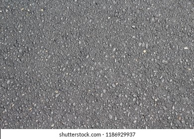 A close view of the paved blacktop pathway texture.