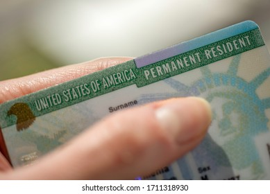 Close up view of Permanent resident card (Green) card of USA on blurred background.