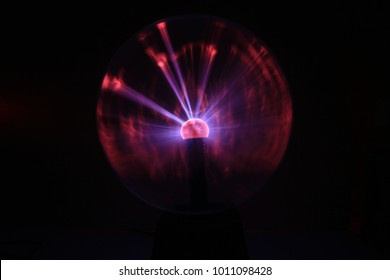 Close up view of a Plasma lamp.  The plasma lamp was invented by Nikola Tesla, during his experimentation with high-frequency currents in an evacuated glass tube for the studying high voltage.