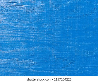Close view of plywood painted a very bright blue.