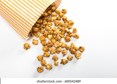 close up view of popcorn in paper container isolated on white