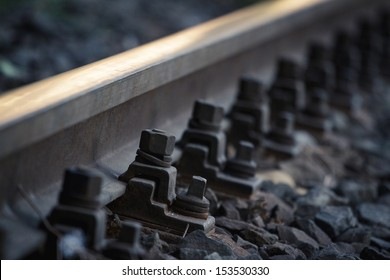 Close up view of railroad bolts
