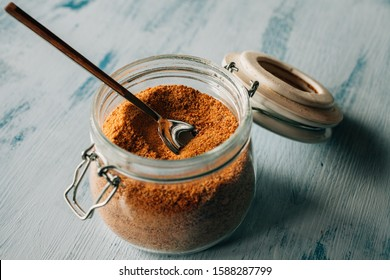 Close up view of raw cane sugar in a jar.  Panela sugar background.