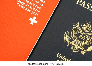 close up view of a red Swiss passport and a blue American passport