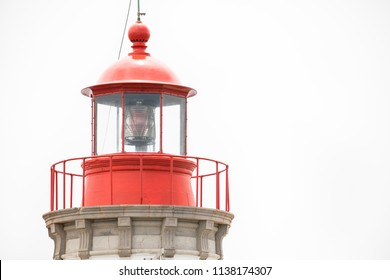 Close up view of a red and white lighthouse light dome