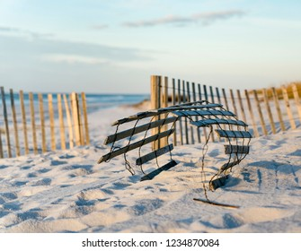 Close view of rolled up sand fence to help prevent erosion at beautiful Florida beach.