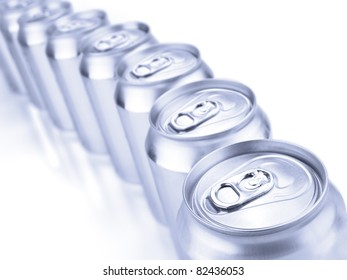 Close up view of a row of tin cans. Shallow depth of field.