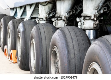 Close up view of a row of tires on the main landing gear of a large transport plane.
