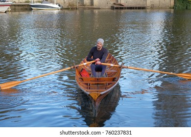 close view of rower on thames skiff boat
