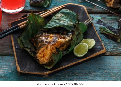 Close view of sambal stingray or malaysian grilled stingray wings in a leaf