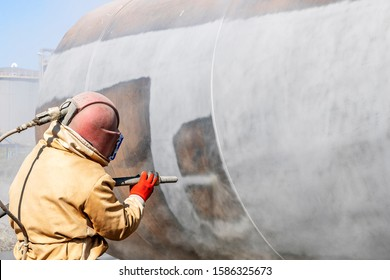 Close up view of sandblasting before coating. Abrasive blasting, more commonly known as sandblasting, is the operation of forcibly propelling a stream of abrasive material against a surface.